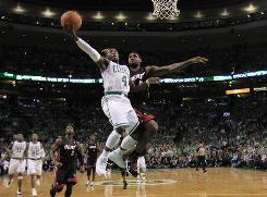Celtics guard Nate Robinson, left, drives to the basket past Heat forward LeBron James during the first half in Boston.