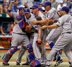 The Rangers mob ace Cliff Lee after he beat the Rays in Game 5 of the ALDS.