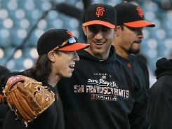 Homegrown starters Tim Lincecum, left, 26, and Madison Bumgarner, 21, are part of a pitching staff that led the majors with a 3.36 ERA.