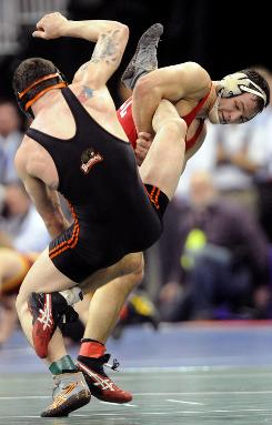 Mack Lewnes, right, taking down Oregon State's Colby Covington during the 2010 NCAA Wrestling Championships in Omaha, and Cornell are the No. 1 squad in the preseason NCAA wrestling poll.