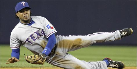 Shortstop Elvis Andrus, left, and closer Neftali Feliz were acquired from the Braves' minor-league system when the Rangers traded Mark Teixeira to Atlanta in 2007.