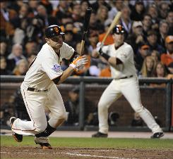 "Giants second baseman Freddy Sanchez hits an RBI single in the eighth inning. Sanchez became the first player to hit doubles in his first three World Series at-bats. ""That's crazy,"" Sanchez said."