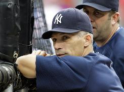 Yankees manager Joe Girardi watches batting practice before Game 6 of the ALCS in Arlington, Texas.