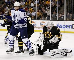 Boston Bruins goalie Tim Thomas, shown making a save as Toronto's Luke Schenn looks on, shut out the Maple Leafs to continue his stellar season.
