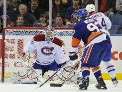 New York Islanders' Doug Weight (93) and Montreal Canadiens' Roman Hamrlik (44) watch Canadiens goalie Alex Auld block the puck during the third period. Montreal won 3-1.