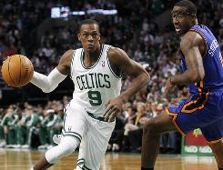 Boston Celtics point guard Rajon Rondo drives past New York Knicks forward Amare Stoudemire during the first quarter on Friday.
