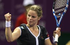 Kim Clijsters celebrates after defeating Samantha Stosur during their WTA Championships semifinal clash.