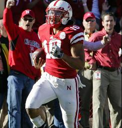 Nebraska running back Roy Helu Jr. runs for one of his three touchdowns against No. 8 Missouri.