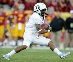 Oregon running back LaMichael James makes a cut during a first-quarter run as the Ducks improved to 8-0.