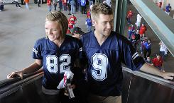 After attending the Cowboys loss down the street, Rebecca Hamilton, 25, and husband Paul Hamilton, 29, ride the escalator to their seats at Rangers Ballpark.