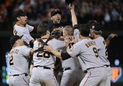 The Giants celebrate on the field after the final out of Game 5 to win the World Series title. It was the franchise's first championship since 1954. 
