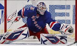 New York Rangers goalie Henrik Lundqvist makes a stop in the second period, one of his 33 saves on the night.