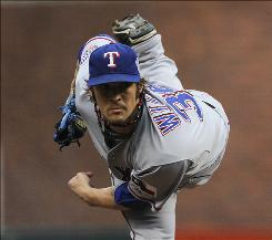 Facing a lefty, such as the Rangers' C.J. Wilson, above, who started Game 2, can force hitters to make adjustments to their swing.