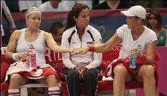 Bethanie Mattek-Sands, left, captain Mary Joe Fernandez, center, and Liezel Huber will lead the USA into the Fed Cup final against Italy this weekend.