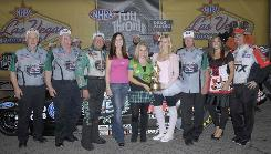 The John Force Racing team, some in costume for Halloween, celebrate a Las Vegas victory by the family patriarch.