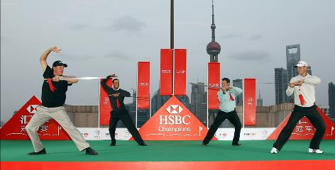 Phil Mickelson of the USA, left to right, Tiger Woods of the USA, Lee Westwood of England and Martin Kaymer of Germany receive a Tai Chi lesson with swords on Tuesday in advance of the WGC-HSBC Champions in Shanghai. Each of the four could be No. 1, currently held by Westwood, by next week.