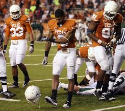 Texas cornerback Curtis Brown (3) throws his helmet down during the second half of the team's loss to Baylor.