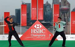 Tiger Woods of the USA and Lee Westwood of England cross swords during a photo shoot in advance of the WGC-HSBC Champions Photocall at The Peninsula hotel in Shanghai on Tuesday. Westwood moved past Woods this week to No. 1 in the world rankings.