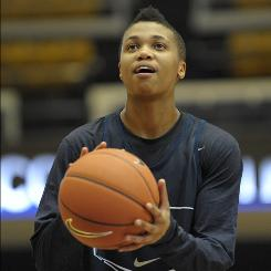George Washington's Kye Allums, putting up a shot during a Colonials women's team practice, received support and praise from teammates after coming out as a transgender male.