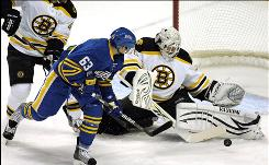 Bruins goalie Tim Thomas, making a save on the Sabres' Tyler Ennis during the first period, stopped 33 Buffalo shots to stay unbeaten on the season.