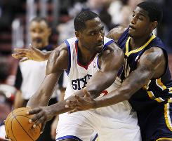 Philadelphia 76ers forward Elton Brand tries to keep the ball from Indiana Pacers center Solomon Jones in the first half on Wednesday.