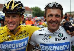 Lance Armstrong, left, and teammate Yaroslav Popovych share a laugh during the 21st stage of the 2005 Tour de France.