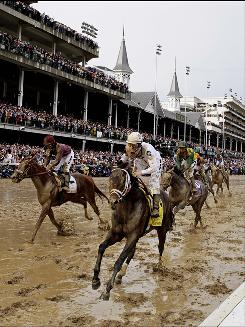 Calvin Borel rides Super Saver in the Kentucky Derby on the dirt at Churchill Downs, site of this weekend's Breeder's Cup.