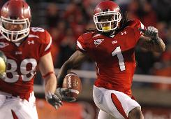 Shaky Smithson, right, averages 23.3 yards a punt return, tops in the nation, for Utah, which is fifth in the BCS standings.