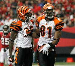 Chad Ochocinco, left, and Terrell Owens have been frustrated by the Bengals' 2-5 start this season.