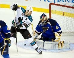 Blues goalie Jaroslav Halak, watching the puck while the Sharks' Ryane Clowe tries to screen him, stopped 25 shots as St. Louis improved to 7-1-2.