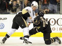 Pittsburgh Penguins center Sidney Crosby, left, who is not exactly known for being a fighter, brawled with Dallas Stars defenseman Matt Niskanen in the second period.