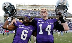 TCU cornerback Elisha Olabode, left, and quarterback Andy Dalton have had plenty of reason to celebrate this season.