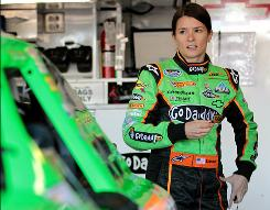 Danica Patrick waits in the garage during practice for the NASCAR Nationwide Series at Texas Motor Speedway.