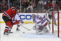 Rangers goalie Henrik Lundqvist, making the stop on a shot from the Devils' Dainius Zubrus during the first period, made 33 saves to keep New Jersey winless at home.