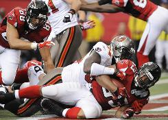 Falcons RB Michael Turner, shown crashing into the end zone for a TD, helped the Falcons beat the Bucs on Sunday.
