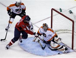 The Capitals' Eric Fehr (16) attempts to shoot the puck by Flyers goalie Sergei Bobrovsky during the second period of Sunday's game in Washington.