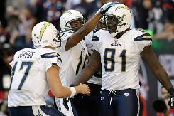 Chargers QB Philip Rivers, left, and wide receiver Gary Banks congratulate tight end Randy McMichael, right, after his touchdown in San Diego's win at Houston on Sunday.