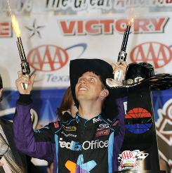 Denny Hamlin shoots celebratory blanks from revolvers in victory lane after sealing a season sweep at Texas Motor Speedway.