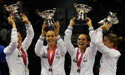 The Italian Fed Cup team of, left to right, Francesca Schiavone, Flavia Pennetta, Roberta Vinci and Sara Errani hold up the trophy after defeating the USA to claim their third Fed Cup title in five years.