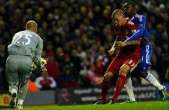 Liverpool's Slovakian defender Martin Skrtel (C) holds Chelsea's Ivorian forward Salomon Kalou during their English Premier League football match against Chelsea at Anfield in Liverpool, northwest England, on Sunday. Liverpool won 2-0. 
