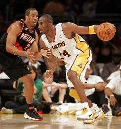 The Lakers' Kobe Bryant drives against the Blazers' Andre Miller in the first half on Sunday.