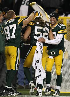 Packers linebacker Clay Matthews, center, is congratulated by teammates Jordy Nelson and Aaron Rodgers after scoring a touchdown in a 45-7 rout of the the Dallas Cowboys in Green Bay, Wis.