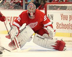 Jimmy Howard of the Detroit Red Wings prepares to make one of his 29 saves on the night.