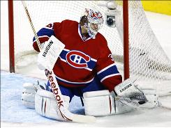 Canadiens goalie Carey Price, making a glove save during the third period, stopped 35 Canucks shots for his second shutout of the season.