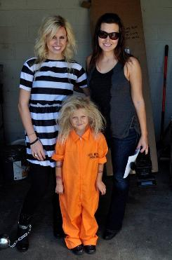 Ashley, left, and her family dressed in costumes.