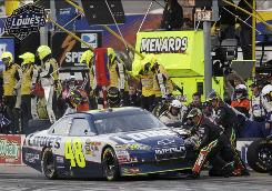 Jeff Gordon's pit crew services Jimmie Johnson's car during a pit stop in the NASCAR Sprint Cup Series auto race at Texas Motor Speedway on Sunday in Fort Worth. Gordon had crashed out of the race and his crew was sent to take over duties for Johnson.