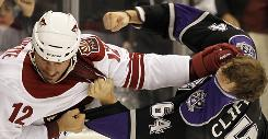 Phoenix Coyotes tough guy Paul Bissonnette, left, has more than 17,000 followers on Twitter.
