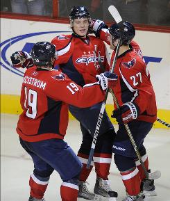 Alexander Semin, center, celebrates his third goal of the game with teammates Nicklas Backstrom and Karl Alzner as the Capitals won their sixth straight game.