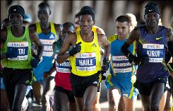 Ethiopian runner Haile Gebrselassie, center, running with the pack during Sunday's New York City Marathon, won two Olympic 10,000-meter gold medals.