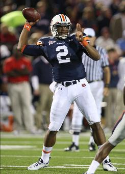 Mississippi State acknowledged Wednesday that it contacted the Southeastern Conference regarding the recruitment of current Auburn quarterback Cam Newton, above.